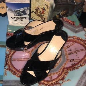 Prada black patent leather wedges in like new cond